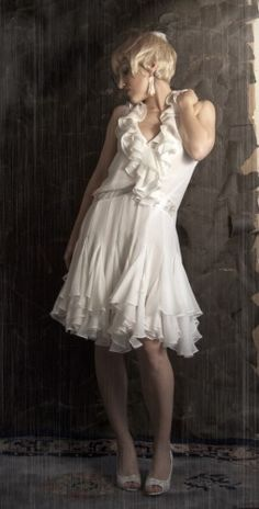 It\'s an awesome little 20\'s flapper style wedding dress by Robin ...