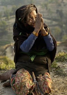 TOUCH this image: An 89-year-old woman greets a passerby in Nagarkot, Nepal... by cnd