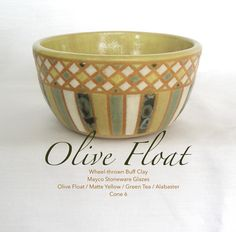 """""""Olive Float"""" is a rather small bowl, measuring 3.5"""" in diameter, and 2"""" tall.  Mayco Stoneware glazes used to decorate the exterior.  Olive Float is a glossy glaze with crystals that burst and expand when the kiln is hot enough. This creates different textures and embeds various colors within the base color. Olive Float crystals are seen on the dark green, vertical stripes."""