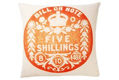 Pillow with copy of British Shilling coin in orange