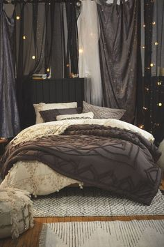 Cozy dark bedroom | shop the look: cream duvet cover - dark comforter - stripe rug - textured rug - sequin pillow - cream sham set - dark tufted sham set - velvet pillow - moroccan pouf - string lights Follow Gravity Home: Blog - Instagram -...
