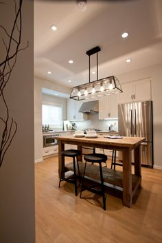 love the light fixture and the simplicity of the kitchen