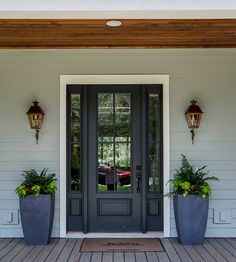 Front door painted with Rock Bottom by Sherwin Williams.  Cottage Home Company. Shuman Mabe Interiors, LLC.
