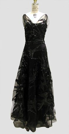 Evening dress Madeleine Vionnet  (French, Chilleurs-aux-Bois 1876–1975 Paris)   Date: fall/winter 1938–39 Culture: French Medium: silk, spangles. Front