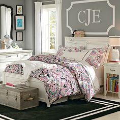 Like the wall color for the bedroom with a pop of color in the bed spread. Peaceful