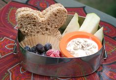 Almond butter honey sandwich with yogurt, berries, and apples