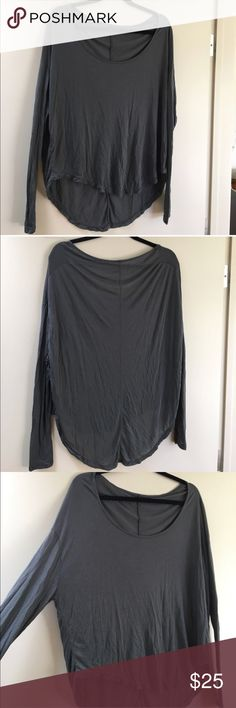 Brandy Melville Long Sleeve Top Never worn top from Brandy Melville. One Size, super soft, fitted sleeves and wide neck. Wrinkles are due to storage. Brandy Melville Tops Tees - Long Sleeve