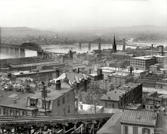 "Circa 1909. ""Cincinnati from Mount Adams."" Bridges over the Ohio River to Kentucky and, foreground, a section of the Mount Adams Incline Railway."