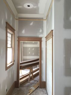 An update on our 1905 craftsman home restoration! Details on all of our trim, moldings, ceilings and shiplap!  shiplap-walls-crown-molding-MDF-baseboards-DIY-windows-window-sashes-panel-doors-black-ceiling-faux-beams-black-sashes-whitewashed-pine-ceiling