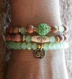 Set of 3 Yoga bracelets, Om, Lotus bead, Pave bead and Genuine Rosewood beads. Meditation, Reiki Charged, free shipping. $29.00, via Etsy.