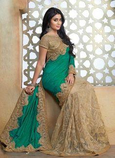Shriya Saran Sea Green Cut Work Silk Net Designer Bollywood Sarees  http://www.angelnx.com/Sarees/Bollywood-Sarees#/sort=p.date_added/order=DESC/limit=32/page=2