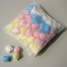 Pink, blue, yellow and white cotton wool balls back in the day