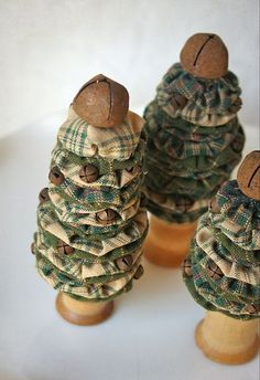 Hilary oozing cuteness! Christmas trees from scraps.