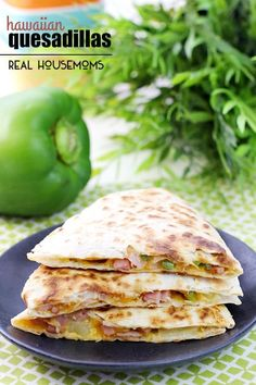 Get dinner on the table quick with these Hawaiian Quesadillas! It's a great way to use up leftover ham! Perfect recipe for breakfast, lunch or dinner!