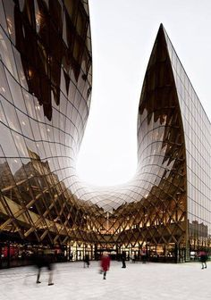 If diamonds were made of chocolate...  Curving planes of diagonal glass stained in smoky brown and caramel tones give this fluid ultra-modern structure a powerful earthy contrast.  A vision of beauty.  Emporia Shopping Centre in Malmö by Wingårdhs