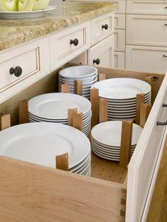 Plates in drawers instead of cabinets.