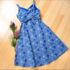 """Blue wrap dress, 6. BEAUTIFUL!! A just gorgeous blue and white floral dress, sz 6. The top has two wraps that come around and tie in back. Full lined. Simply beautiful!  Dress length is 42"""". THIS would be perfect for spring and summer events, showers, graduations, and concerts! Amelia Dresses Midi"""