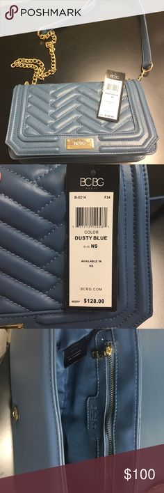Dusty Blue BCBG Paris NWT!! Lovely purse by BCBG Paris NWT. The inside closure has some scratches, just probably being in the store. This has already been taken into account. Reasonable offers welcome. No Trades. BCBG Paris Bags Mini Bags