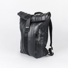 Hi, I'm Arce, I'm the perfect unisex black backpack to carry everything you want and more. I'm made of black bicycle inner tube. I'm waterproof