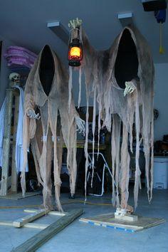 50 Halloween Ideas.....Cloaked Ghosts Halloween yard decoration
