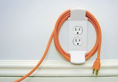 Electric outlet cord wrap --how clever! (This would be great for regular cords that are too long and hazardous to crawlers. MJ)