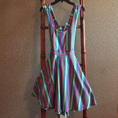 Striped and colorful, summer, open-backed dress. Flirty, semi-backless dress! Only worn once, in great condition. There's a slight stretch to the material. No slip needed. Great swimsuit pullover or transitional night out piece. Young Threads Dresses