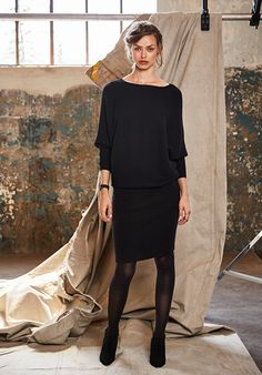 "Super soft and so sophisticated, this knitted dress has a slouchy top with dolman sleeves and fits neatly on the hips for a relaxed chic look. • Knee-length, relaxed at the top, close fitting through the skirt. • Slash neck and ribbed cuffs. • Pull on style. • Soft cashmere wool mix. • Length 111.7cm (size S). • Model is 5'9"" and wears size S."