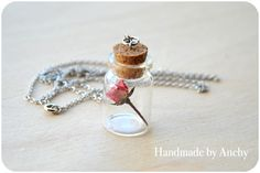 Small bottle with real dry pink rose flower by HandmadeByAnchy