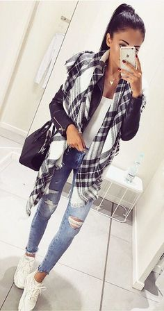 #fall #outfits  women's black and white shawl and blue distress jeans