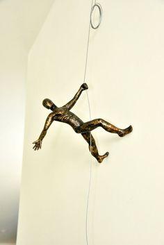 Man Climbing Sculpture Wall Art