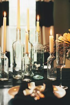 candles in wine bottles. love this idea!!! i know me and my bridesmaids could drink and save all the bottles we need :)