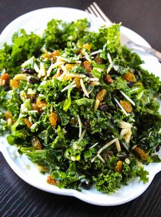 Lemon Parmesan Kale Salad-For the dressing:      2 Tablespoons olive oil     1 Tablespoon lemon juice     1 Tablespoon basil, minced     ½ Tablespoon parmesan cheese, grated     ½ small clove garlic, minced     ½ Tablespoon shallots, minced     ½ Tablespoon Dijon mustard  For the salad:      1 bunch organic green kale, stemmed     1 cup romaine lettuce, chopped     2 tablespoons freshly grated parmesan cheese     ½ cup golden raisins     2 Tablespoon currants     1 tablespoon slivered…