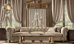 Rooms | Restoration Hardware- I like the coffee table in front of the chesterfield, then the candle holders behind the sofa, reflected in the mirror. Maybe we can try to layer the elements like this in your house? A mirror of sorts would make the room feel larger.