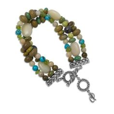 """Sterling Silver Multi-Gemstone Triple-Strand Beaded Bracelet American Gems. $69.98. Genuine .925 Sterling Silver. Lifetime Warranty on Jewelry, Proudly American Made. Mined and Manufactured in the United States. Natural Gemstones: Brown Feldspar, Turquoise, Calcite, Chaceldony and Peridot. Adjustable 8"""" to 8-3/4"""" L, Toggle Bar Clasp"""
