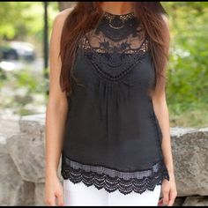 Black Sheer Chiffon Crochet Lace Top Black chiffon top with crochet lace edging at top and bottom. Very sheer and see through.  Roomy enough to wear over a tank top. Back of top as button closure. I have added a photo of the same top in pink so as to see the button closure better.  Hand wash cool. Tank top shown under top in photo not included. Tops Blouses