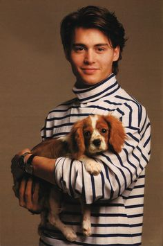 johnny depp, with dog, in a striped turtleneck sweater. yeah.