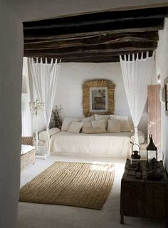 bedroom - earthy architecture, white walls, timer on ceiling. love the light earth tones of the furnishings