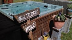 Old Sign Waterin' Hole