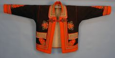 YUGOSLAVIAN EMBROIDERED WOOL COAT, 20th C. Brown felt with orange felt trim, brightly colored embroidery and soutache with single frog closure.