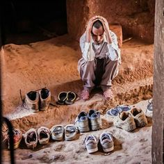 The shoe man in Lalibela. Guardian of our shoes and clearly confused about which pair belongs to which faranji. :) #OasisOverland #history #religion #culture #ethiopia #overlandtravel #africa #explore #overland #adventure #tlpicks #travel #traveler #wanderlust #travelblogger #adventuretravel #relax #travelstroke #thisistravel #takemethere #cntravel #bbctravel #onlyinAfrica #bucketlist #travelphotos #photography #livetravelchannel by divergenttravelers