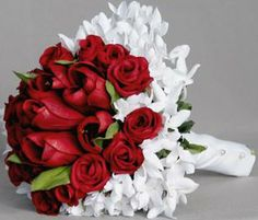 Bouquet Bridal: Red Roses and Small White Flowers Bouquet. How about this, but replace the small white flowers with ivory orchids?