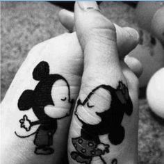 And this adorable black & white kissing one. | 43 Adorable Couples' Tattoos That Will Stand The Test Of Time