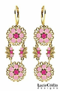 European Style 14K Yellow Gold over .925 Sterling Silver Dangle Earrings by Lucia Costin with Filigree and Leaf Elements, Ornate with 6 Petal Flowers, Fuchsia and Light Pink Swarovski Crystals; Handmade in USA Lucia Costin. $87.00. Floral design accompanied by cute details. Crafted with fuchsia and light rose Swarovski crystals. Dangle earrings beautifully designed by Lucia Costin. Mesmerizing enough to wear on special occasions, but durable enough to be worn dai...