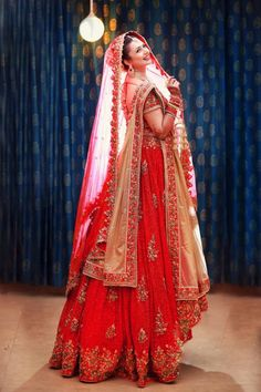 Indian Traditional Bridal Beauty in Bright Red Lehenga Indian Bridal Outfits, Indian Bridal Lehenga, Indian Bridal Wear, Indian Dresses, Bridal Dresses, Red Lehenga, Plus Size Brides, Bride Poses, Bridal Photoshoot