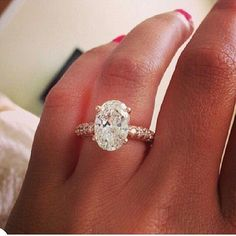DREAM RINGLove this. I live the oval diamonds without the diamonds outlining the main stone