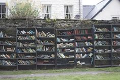 … with its outdoor shelves lining the outer walls of the castle. | There's A Village In Wales That Is Basically One Big Library