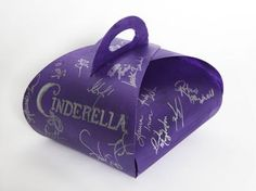 We all know (and love!) Rodgers + Hammerstein's CINDERELLA and now you can bring a part of the Tony Award®-winning Broadway musical intor your home! Bid on this special Cronut™ carrier, signed by the cast of CINDERELLA and keep the carrier of your dreams! And don't worry -- you don't need to return it by midnight! – it's yours to keep! This box will include two custom Cronuts™ created by Chef Ansel, filled with pumpkin cream and topped with 24K gold leaf.