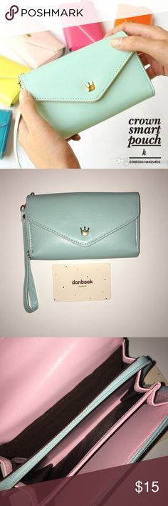 NWT Donbook Wristlet blue leather donbook phone holder, wallet, and card holder wristlet. brand new with tag Donbook Bags Clutches & Wristlets