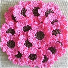 looks like 9hdc in brown then 9 pink petals around (try ss,ch2or3,dc, dc ch2or3,ss in each stitch.