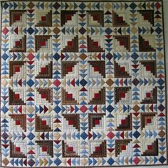 An original pattern to combine my favorite elements in a quilt Log Cabin Blocks and Flying Geese My version is based on browns blues dark red and creams This pattern